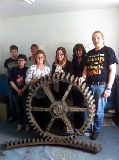 Dulverton Laundry staff with cogwheel casting pattern found in laundry attic